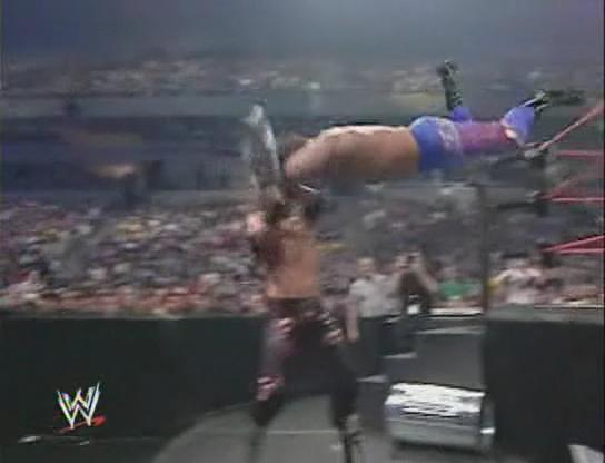 "Chris Benoit taking a steel chair shot to the head during a missed ""Flying Headbutt""."