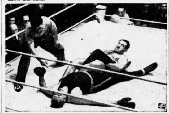 Jack Sherry forced boxer Phil Scott to give up to an leg lock in their 1938 contest. Sherry had an open challenge to any boxer or judoka to last 100 seconds with him.